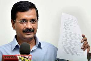 Former Delhi chief minister and AAP convener Arvind Kejriwal showing the list of those who have bank accounts in foreign banks at a press conference, in New Delhi.