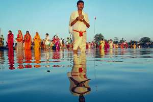 Devotees offering prayers during Chhath festival at the banks of Brahmaputra River in Dibrugarh, Assam.