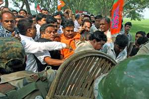 Police stop BJP leaders and supporters from entering the violence-hit area of Makra village under Parui in Birbhum district of West Bengal.