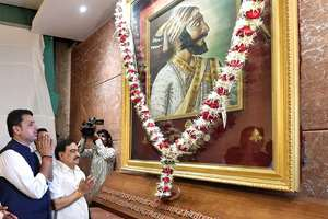 Maharashtra Chief Minister Devendra Fadnavis along with cabinet minister Eknath Khadse paying tribute to Chhatrapati Shivaji at Mantralay after the swearing-in ceremony in Mumbai.