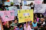 Students shout slogans during a protest against the school management of Indiranagar Cambridge School, where a 6 year old girl was raped, in Bengaluru.