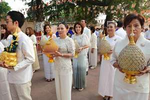 Thai devotees taking part in robe offering procession at Mahabodhi Temple in Bodhgaya.