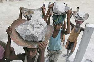 India is world's slave capital, 14.2 mn involved in trafficking or forced labour, says 2014 Global Slavery Index. Worldwide, 35.8 mn in trouble, 65% of victims are Asian. Pak, B'desh, Nepal all top offenders.