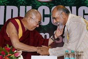 Tibetan spiritual leader the Dalai Lama with C. V. Vigneswaran (Sri Lanka) at the inauguration of World Hindu Congress 2014, in New Delhi.