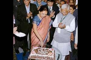 Gujarat Chief Minister Anandiben Patel cutting a cake to celebrate her birthday in Gandhinagar.