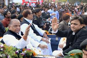 SP chief Mulayam Singh Yadav with his son and UP CM Akhilesh Yadav riding a Royal Buggy, brought from London, at an event to celebrate his 76th birthday in Rampur.