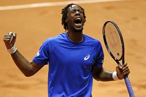 France's Gael Monfils celebrates a winning point as he plays Switzerland's Roger Federer during the Davis Cup final in Lille, northern France. Monfils won 6-1, 6-4, 6-3 to give France a 1-1 draw.