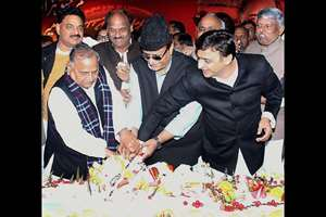 Samajwadi Party supremo Mulayam Singh Yadav with Uttar Pradesh Chief Minister Akhilesh Yadav and Azam Khan cutting cake on the occasion of Mulayam Singh Yadav's 76th birthday.