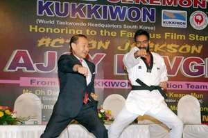 Actor Ajay Devgan being awarded with Dan Black Belt by Taekwondo Masters from Korea in Mumbai.