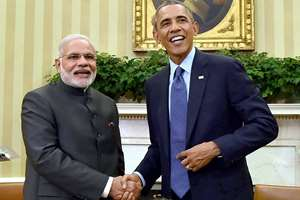 File Photo- Prime Minister Narendra Modi shakes hands with US President Barack Obama in the Oval Office of the White House in Washington. Obama will be the first United States president to be the chief guest at Republic Day celebrations in January 2015.