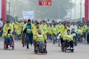 Differently-abled atheletes participate in Airtel Delhi Half Marathon 2014 in New Delhi.