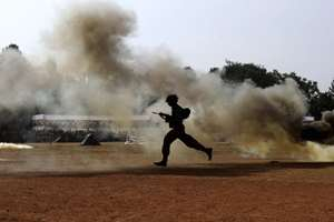 A student dressed like an army takes part in a drill to mark the NCC Day in Bhubaneswar.