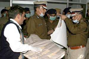 Haryana DGP S N Vashist inspecting the bullet proof jacket which was recovered from Ramlal's Satlok Asharam in Hisar.
