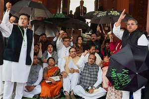 TMC MPs protest over black money issue during the winter session of Parliament in New Delhi.
