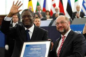 Doctor Denis Mukwege, from the Democratic Republic of Congo, a gynecologist who specialises in treating victims of rape and extreme sexual violence, gets the Sakharov Prize 2014 from Parliament President Martin Schulz at the European Parliament in Strasbourg eastern France. The prize honors individuals and groups of people who have dedicated their lives to the defense of human rights and freedom of thought.
