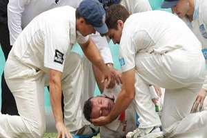 Australia Test batsman Phil Hughes falls on the ground after being knocked out by a bouncer during a match between Sheffield Shield and NSW at the SCG. The 25-year-old collapsed after being struck on the side of the head by a Sean Abbott delivery and was stretchered from the ground. He is currently undergoing surgery and is in a critical condition.