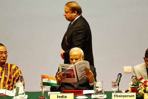 Pakistani Prime Minister Nawaz Sharif walks past Prime Minister Narendra Modi during the 18th summit of the South Asian Association for Regional Cooperation (SAARC) in Katmandu, Nepal.