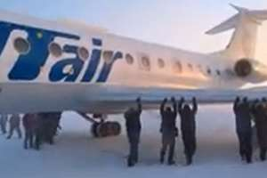 Video Grab: Siberia air passengers push their plane in temperatures of minus 52 degrees Celsius after its chassis froze.