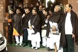 After black umbrellas, it was black shawls that Trinamool Congress members used in Lok Sabha to rake up the issue of black money at the Parliament, in New Delhi.
