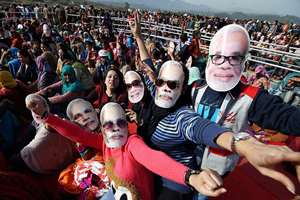 BJP supporters wearing masks of Prime Minister Narendra Modi shout slogans at his election rally in Udhampur district, Jammu and Kashmir.