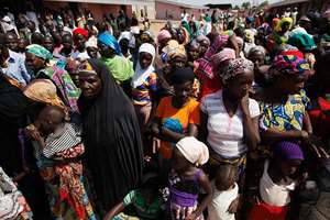 Civilians who fled their homes following an attack by Islamist militants, in North East congregate at the camp for internally displaced people in Yola, Nigeria. Thousands of people have fled their homes in recent times due to Boko Haram attackes.