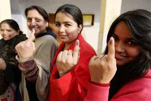 Voters show their inked fingers after casting their votes during the J&K assembly elections in Jammu.
