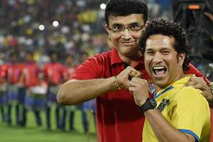Kerala Blaster FC team owner Sachin Tendulkar along with Atletico De Kolkata owner Saurav Ganguly during the final match of Hero Indian Super League in Mumbai.