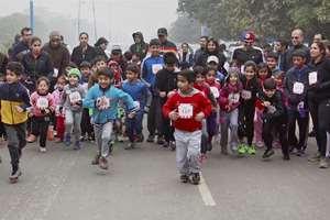 Children Participate during the 'Run for Kids Safety' half marathon in Gurgaon.