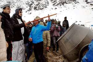 Chief Minister of Uttarakhand Harish Rawat along with other officials inspect the construction works in Kedarnath.