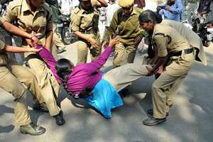 Police personnel arrest Indira Kranti Padakam activists during Chalo Assembly rally demanding to pay pending salaries, in Hyderabad.