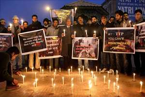 Lawyers and Locals holding candle light vigil to pay tribute to victims of Taliban terror attack in Peshawar, at Ghanta Ghar, in Srinagar.