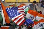 Men fold the U.S. and Indian flags at a shop in Mumbai.