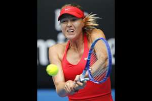Maria Sharapova of Russia makes a backhand return to Peng Shuai of China during their fourth round match at the Australian Open tennis championship in Melbourne, Australia.