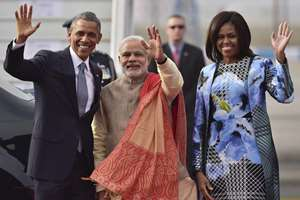 Prime Minister Narendra Modi with visiting US President Barack Obama and first lady Michelle Obama wave upon their arrival at Air Force station Palam, in New Delhi.