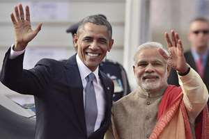 Prime Minister Narendra Modi with visiting US President Barack Obama waves to newsmen upon his  arrival at Air Force station Palam, in New Delhi.