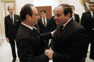 French President Francois Hollande, left, shakes hands with Egyptian President Abdel Fattah al-Sisi during a meeting  in Riyadh.