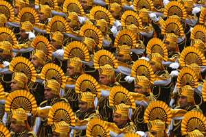Paramilitary soldiers march during the Republic Day parade, in New Delhi.