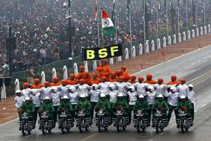 Border Security Force soldiers perform a motorcycle stunt during Republic Day parade in New Delhi.