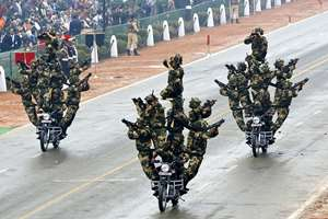 Border Security Force daredevils perform a motorcycle stunt during Republic Day parade, in New Delhi.