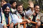 Congress Vice President Rahul Gandhi with Delhi Congress President Arvinder Singh Lovely waves during a road show at Kalkaji for forthcoming Assembly elections, in New Delhi.