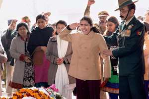 The daughter of Col MN Rai cries as she salutes to pay her last respect to his mortal remains during his cremation at the Delhi Cantt, in New Delhi.