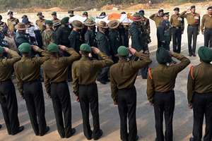 Senior army officials carry the mortal remains of Col MN Rai during his cremation at the Delhi Cantt, in New Delhi.