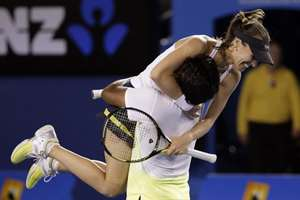 MelbourneMartina Hingis of Switzerland, top,  and Leander Paes of India celebrate after defeating Kristina Mladenovic of France and Daniel Nestor of Canada in the mixed doubles final at the Australian Open tennis championship in Melbourne, Australia.
