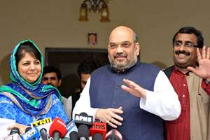 PDP leader Mehbooba Mufti (left) and BJP president Amit Shah speak to the media after their meeting, formally announcing an alliance between the two parties, in New Delhi.