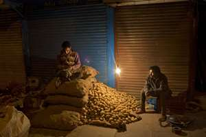 Vendors wait for early morning customers at the wholesale vegetable market in the old city area of New Delhi.