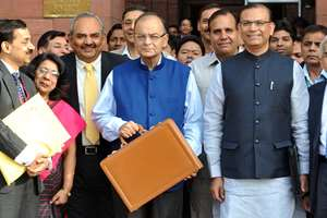 The Union Minister for Finance, Corporate Affairs and Information & Broadcasting, Arun Jaitley departs from North Block to Parliament House along with the Minister of State for Finance, Jayant Sinha to present the General Budget 2015-16, in New Delhi.