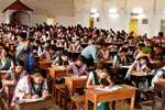Students appear for class 12th Board exams in a school, at Agartala, Tripura.
