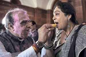 BJP MPs Jagadambika Pal and Kirron Kher celebrate holi at Parliament House, in New Delhi.