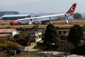 A Turkish Airlines jet that skidded off a slippery runway while landing in dense fog is seen at Tribhuwan International Airport in Kathmandu, Nepal.The plane with 238 people on board was coming from Istanbul when the accident happened. Officials say passengers had bumps and bruises but no serious injuries.