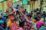 Foreign tourists take part in Holi celebrations, in Kolkata.